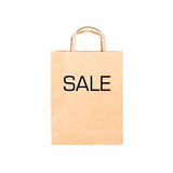 Рециркулируйте коричневую бумажную сумку с ПРОДАЖЕЙ знака Стоковые Фото