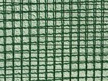 Решетка металла и зеленая текстура стены цемента Стоковая Фотография
