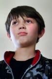 Решительно молодой темный с волосами мальчик Стоковые Изображения
