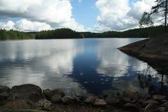 Релаксация на озере Стоковые Фото