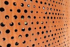 Ржавая металлическая предпосылка с отверстиями Стоковые Фотографии RF