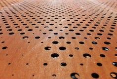 Ржавая металлическая предпосылка с отверстиями Стоковые Фото
