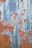 Ржавая текстура металла с пестротканой предпосылкой Стоковое Фото