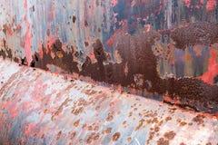 Ржавая текстура металла с пестротканой предпосылкой Стоковое Изображение RF