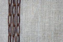 Ржавая цепь на ткани Стоковое Изображение