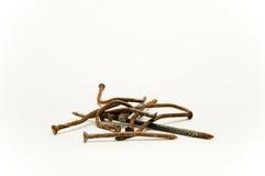 Ржавые нечестные ногти изолированные на белой предпосылке Стоковые Фото