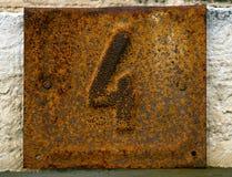 Ржавый номерной знак 4 дома Стоковая Фотография RF