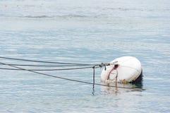 Ржавый томбуй в воде порта стоковые фотографии rf