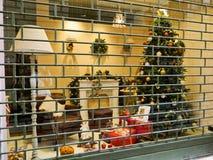 Римини, Италия - 25-ое декабря 2014: Магазин окна рождества в Римини Украшения рождества в окне магазина стоковое фото