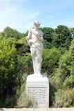 Римская греческая статуя человека играя трубу лотка Стоковая Фотография RF