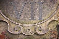 Римский номер написанный на стене штукатурки - изображение концепции стоковое фото