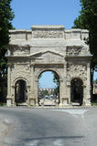 Римское Арч Де Триомпюе на померанце Стоковое фото RF