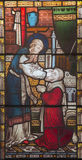 РИМ, ИТАЛИЯ - 9-ОЕ МАРТА 2016: Ananias восстанавливая визирование к Saul на цветном стекле всей Англиканской церкви ` Святых Стоковая Фотография