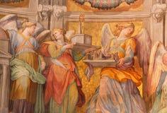 Рим - фреска ангелов в sancturary в di Santa Maria базилики церков в Trastevere от 17 цент Domenichino (1581 до 1641) Стоковое Фото