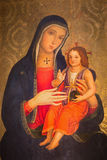 Рим - Madonna Романо Antoniazzo (поздно 15 цент ) в dei Santi XII Apostoli базилики церков Стоковое Фото