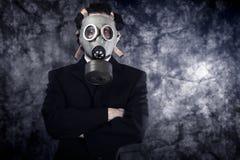 Рискните принципиальную схему, бизнесмена с маской противогаза и черный костюм Стоковая Фотография RF