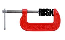 Риск обхваченный в красной струбцине Стоковые Изображения