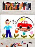 Рисовать: молодой человек мечтая о новом красном автомобиле стоковые изображения rf