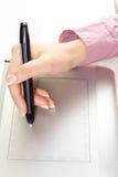 Рисовать на графической таблетке Стоковые Изображения RF