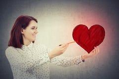 Рисуя большое сердце Стоковое Фото