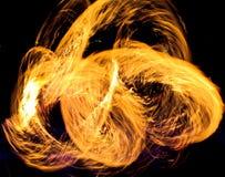 Рисуя огонь на ноче Стоковое Фото