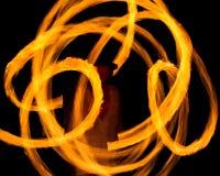 Рисуя огонь на ноче Стоковые Фото
