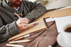 Рисуя человек стоковое изображение