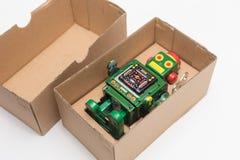 Робот в коробке Стоковая Фотография