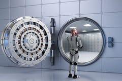 Робот работая с банковским хранилищем Стоковое фото RF