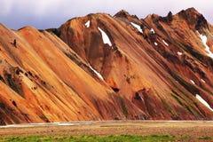 Ровные оранжевые горы риолита Стоковая Фотография