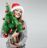 Рождественская елка владением девушки Санты Стоковое Фото