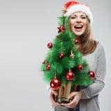 Рождественская елка владением девушки Санты Стоковое Изображение