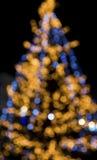 Рождественская елка освещает предпосылку Стоковые Фотографии RF