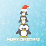 Рождественская открытка вектора с Рождеством Христовым с пингвинами установила на голубую предпосылку с падая снежинками пингвины Стоковые Изображения RF