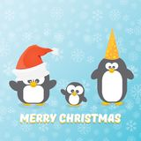 Рождественская открытка вектора с Рождеством Христовым с пингвинами установила на голубую предпосылку с падая снежинками пингвины Стоковое Изображение RF