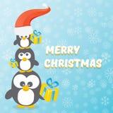 Рождественская открытка вектора с Рождеством Христовым с пингвинами установила на голубую предпосылку с падая снежинками пингвины Стоковая Фотография RF