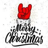 рождество веселое Рука Санта Клауса с знаком рок-н-ролл бесплатная иллюстрация