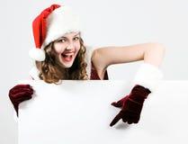 рождество женский держа santa карточки белый Стоковая Фотография