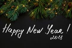 Рождество Игрушки Xmas и елевая ветвь на черном взгляд сверху предпосылки Космос для текста Стоковое Фото