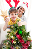 рождество украшая вал сынка отца Стоковое Изображение