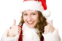 рождество claus santa показывает большие пальцы руки вверх по женщине Стоковая Фотография RF