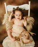 рожочок золота ребенка ангела коричневый немногая Стоковые Фото