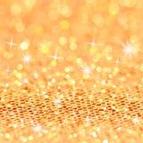 Рождества золота моргать предпосылка. Bokeh и звезды Стоковое Изображение