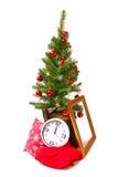 Рождественская елка, пень, рамка, часы и подушка Стоковые Изображения