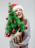 Рождественская елка владением девушки Санты Стоковая Фотография RF