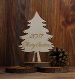 Рождественская елка на stub на деревянной предпосылке Стоковое Изображение RF