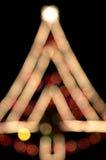 Рождественская елка освещает bokeh Стоковые Изображения RF