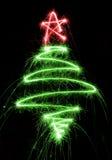 Рождественская елка сделанная бенгальским огнем на черноте Стоковые Фотографии RF