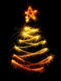 Рождественская елка сделанная бенгальским огнем на черноте Стоковая Фотография