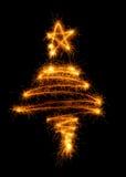 Рождественская елка сделанная бенгальским огнем на черноте Стоковые Фото